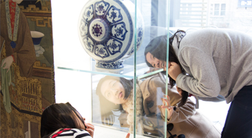 Three girls looking at a museum exhibit