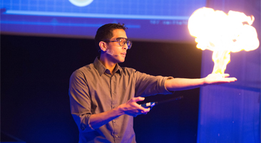 Man giving a presentation and a fireball erupting from his hand