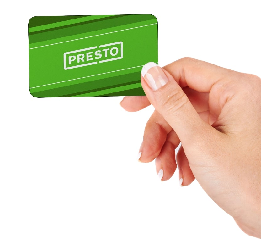 Image of a hand holding a green PRESTO card